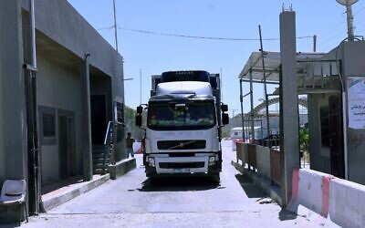 A truck passes into Gaza through the Kerem Shalom crossing, the main passage point for goods entering the Strip from Israel on May 18, 2021. (Said Khatib/AFP)