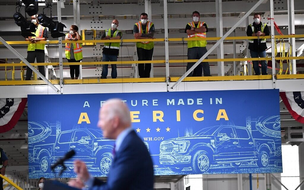 Workers listen to US President Joe Biden speak at the Ford Rouge Electric Vehicle Center, in Dearborn, Michigan on May 18, 2021. (Nicholas Kamm / AFP)
