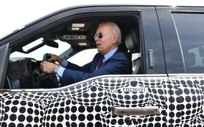 US President Joe Biden drives the new electric Ford F-150 Lightning at the Ford Dearborn Development Center in Dearborn, Michigan on May 18, 2021. (Nicholas Kamm / AFP)