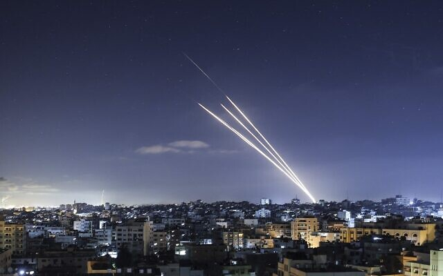 Illustrative: Rockets are launched towards Israel from Gaza City, controlled by the Palestinian Hamas terror group, on May 18, 2021. (Photo by MAHMUD HAMS / AFP)