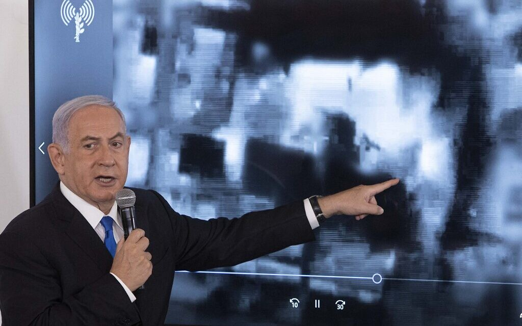 Prime Minister Benjamin Netanyahu gestures as he shows a slideshow during a briefing to ambassadors to Israel in Tel Aviv on May 19, 2021 (Sebastian Scheiner / POOL / AFP)