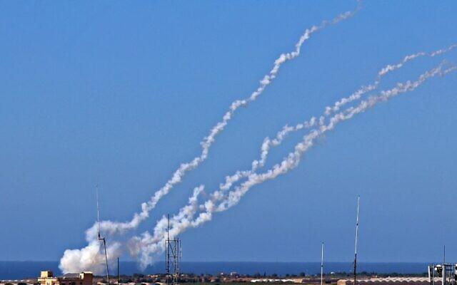 Rockets are fired by Palestinian terrorists toward Israel, near Rafah in the southern Gaza Strip, May 19, 2021. (Said Khatib/AFP)