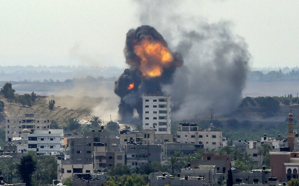 A ball of fire erupts from a building in Gaza City's Rimal residential district on May 20, 2021, during an Israeli bombardment on the Hamas-controlled enclave following rocket fire (BASHAR TALEB / AFP)