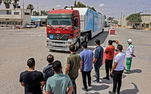 A Jordanian mobile field hospital passes into Rafah in the southern Gaza Strip, through the Kerem Shalom crossing, the main passage point for goods entering Gaza from Israel, on May 21, 2021, after a ceasefire brokered by Egypt between Israel and the Palestinian Hamas  terror group. (SAID KHATIB / AFP)