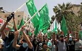 Palestinian supporters of Hamas, gather to celebrate the ceasefire between Hamas and Israel on May 21, 2021, in the West Bank town of Hebron. (HAZEM BADER / AFP)