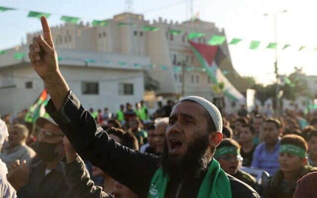 Palestinian supporters of the Hamas terror group's military wing attend a parade in Khan Yunis, in the southern Gaza Strip on May 27, 2021, as Hamas claims victory following an 11-day conflict with Israel.(SAID KHATIB / AFP)