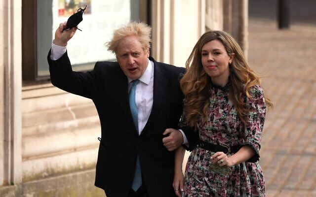 In this file photo taken on May 6, 2021, Britain's Prime Minister Boris Johnson and partner Carrie Symonds arrive at Methodist Hall in central London to cast their votes in local elections. (AFP)