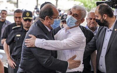 Yahya Sinwar (R), Hamas' political chief in Gaza, embraces General Abbas Kamel (L), Egypt's intelligence chief, as the latter arrives for a meeting with leaders of Hamas in Gaza City on May 31, 2021. (MAHMUD HAMS / AFP)