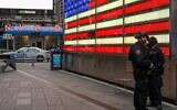 Police officers are seen in Times Square on May 8, 2021 in New York City.(David Dee Delgado / GETTY IMAGES NORTH AMERICA / Getty Images via AFP)