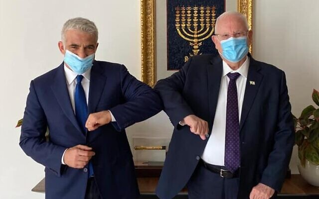 Yesh Atid chairman Yair Lapid with President Reuven rivlin on July 8, 2020. (Yair Lapid/Facebook)