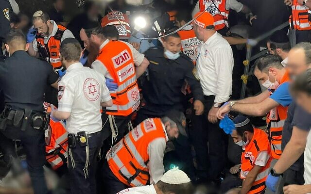 Rescuers at Mount Meron, shortly after tragedy unfolded. Avi Marcus, director the the medical department at United Hatzalah of Israel, is top left. (courtesy of United Hatzalah)