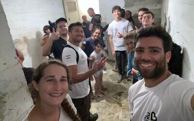Shlomo Lampert, far right, who founded Ir Miklat, an organization dedicated to clearing out apartment bomb shelters in poor Israeli neighborhoods during the recent crisis with Gaza (Courtesy Shlomo Lampert)