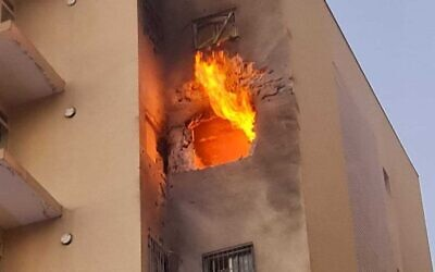 The scene of a direct rocket hit on a building in Sderot, southern Israel, on May 12, 2021 (Sderot Municipality)