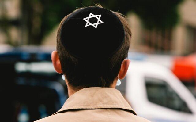 A man with a Jewish kippa (Ying Tang/NurPhoto via Getty Images, JTA)