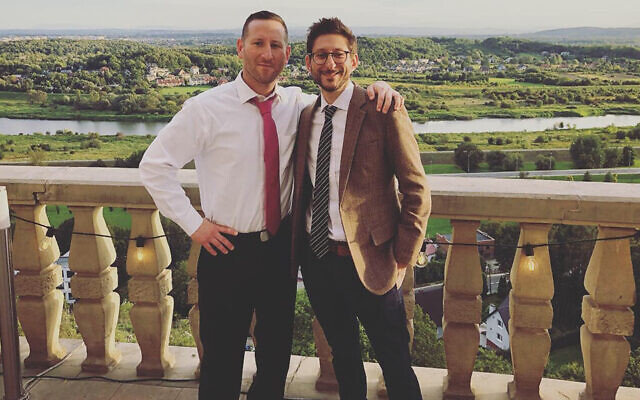 Danny Fenster, right, with his brother Bryan at a friend's wedding in Krakow, Poland in September 2019. (Courtesy of Bryan Fenster via JTA)