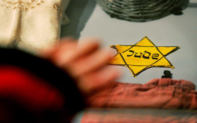 A yellow Star of David Jews were forced to wear by the Nazis, is seen with other belongings of holocaust survivors from the Auschwitz-Birkenau concentration camp that are on display at the Yad Vashem Holocaust Memorial in Jerusalem, Jan. 24, 2005 (AP Photo/Kevin Frayer)