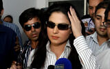 Pakistani actress Veena Malik talks to media at a local police station in Lahore, Pakistan on April 13, 2010. (AP Photo/K.M.Chaudary)