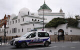 Illustrative: A police car drives past the Grand Mosque in Paris, Friday, March 15, 2019. (AP Photo/Francois Mori)