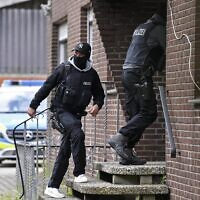 Special police during an investigation into links to the Hezbollah terror group seen in Muenster, western Germany, April 30, 2020. (Martin Meissner/AP)