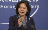 China's Foreign Ministry spokesperson Hua Chunying gestures during a press conference held at the Foreign Ministry in Beijing on December 10, 2020. (AP Photo/Liu Zheng)
