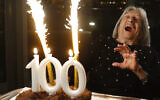 Illustrative image: Agnes Keleti, former Olympic gold medal winning gymnast, reacts to fireworks going off on her birthday cake in Budapest, Hungary Monday Jan. 4, 2021.  (AP Photo/Laszlo Balogh)