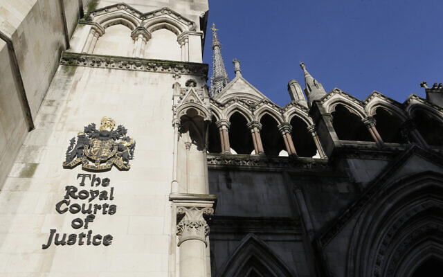 A view of the Royal Courts Of Justice, which houses the High Court, in London, Jan. 19, 2021. (AP Photo/Kirsty Wigglesworth)