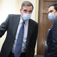 Committee Chairman Senator Mark Warner, left, and vice chairman Senator Marco Rubio, arrive for the Senate Select Intelligence Committee confirmation hearing for William Burns, nominee for Central Intelligence Agency director, February 24, 2021 on Capitol Hill in Washington. (Tom Williams/Pool via AP)