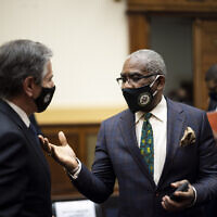 Secretary of State Antony Blinken talks with Rep. Gregory Meeks, D-N.Y., after a House Committee on Foreign Affairs hearing on the administration foreign policy priorities on Capitol Hill on Wednesday, March 10, 2021, in Washington. (Ting Shen/Pool via AP)