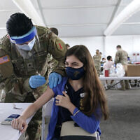 Natalie Ruiz,19, receives the Pfizer COVID-19 vaccine at a FEMA vaccination center at Miami Dade College, Monday, April 5, 2021, in Miami.  (AP Photo/Lynne Sladky)