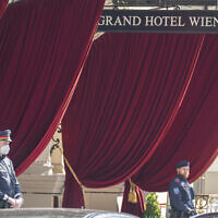 Police officers stand in front of the 'Grand Hotel Wien' in Vienna, Austria, Friday, April 9, 2021, where closed-door nuclear talks with Iran take place. (AP Photo/Florian Schroetter)
