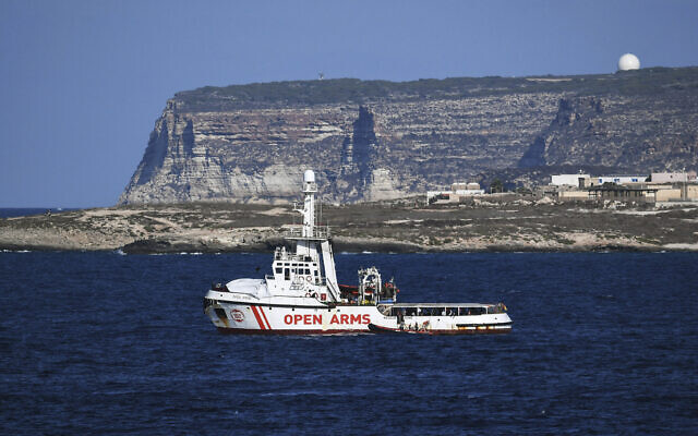 In this Aug. 19, 2019 file photo, Open Arms vessel with 107 migrants on board is anchored off the Sicilian island of Lampedusa, southern Italy. (AP Photo/Salvatore Cavalli)