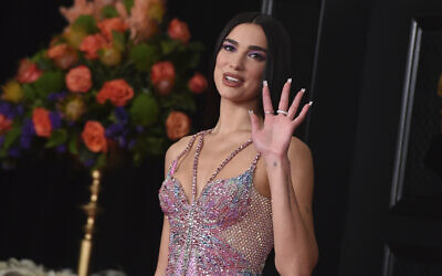 Dua Lipa arrives at the 63rd annual Grammy Awards at the Los Angeles Convention Center, March 14, 2021. (Photo by Jordan Strauss/Invision/AP, File)