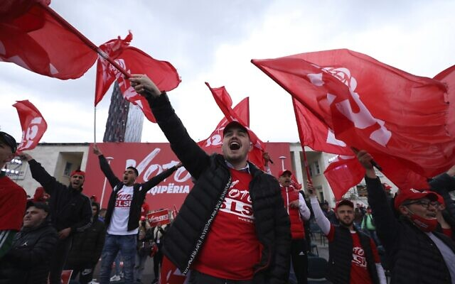 Supporters of the Socialist Party wave flags during a rally of their party in Tirana, Albania, April 22, 2021. (AP)