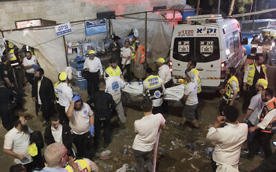Security officials and rescuers at the scene of a fatal crush during Lag B'Omer celebrations at Mt. Meron in northern Israel, April 30, 2021. (AP Photo)