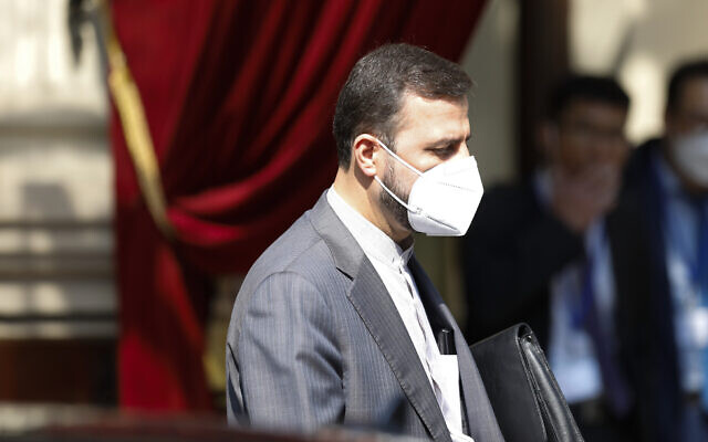 In this file photo dated April 20, 2021, Iran's governor to the International Atomic Energy Agency, IAEA, Kazem Gharib Abadi leaves the 'Grand Hotel Vienna' where closed-door nuclear talks take place in Vienna, Austria. (AP Photo/Lisa Leutner, FILE)