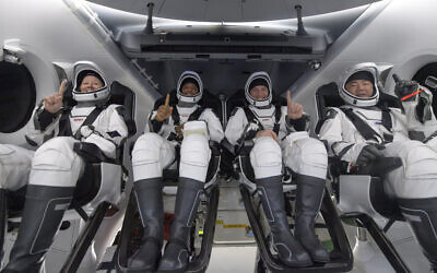 NASA astronauts Shannon Walker, left, Victor Glover, Mike Hopkins, and Japan Aerospace Exploration Agency (JAXA) astronaut Soichi Noguchi, right are seen inside the SpaceX Crew Dragon Resilience spacecraft onboard the SpaceX GO Navigator recovery ship shortly after having landed in the Gulf of Mexico off the coast of Panama City, Florida, Sunday, May 2, 2021. (Bill Ingalls/NASA via AP)