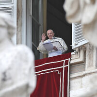 Pope Francis waves after delivering the Regina Caeli noon prayer from the window of his studio overlooking St.Peter's Square, at the Vatican, May 2, 2021. (AP Photo/Alessandra Tarantino)