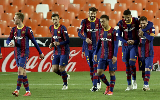 Barcelona's Lionel Messi (R) celebrates with teammates after scoring his side's 3rd goal during the Spanish La Liga soccer match between Valencia and Barcelona at the Mestalla stadium in Valencia, Spain, May 2, 2021. (AP Photo/Alberto Saiz)