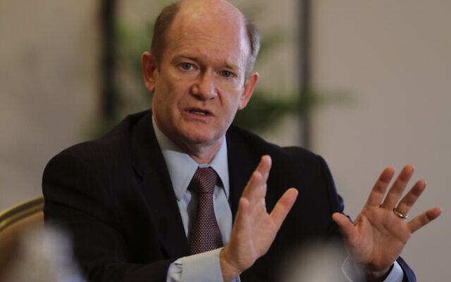 Senator Chris Coons of Delaware talks to the journalists during a press briefing in Abu Dhabi, United Arab Emirates, on May 3, 2021. (AP/Kamran Jebreili)