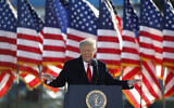 US President Donald Trump speaks to crowd before boarding Air Force One at Andrews Air Force Base, Md., January 20, 2021. (AP Photo/Luis M. Alvarez, File)