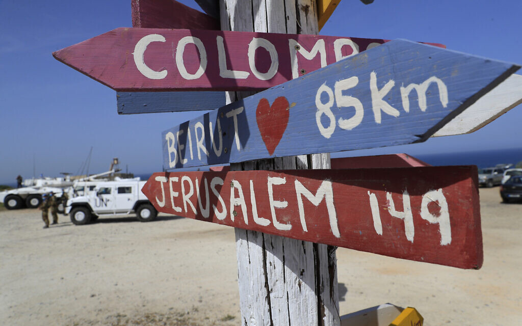 Signs shows the distances of Beirut and Jerusalem, that set at a road that links to a UNIFIL base where the Lebanese and Israeli delegations meet, in Naqoura, Lebanon, Tuesday, May 4, 2021. (AP/Hussein Malla)