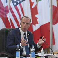 Britain's Foreign Secretary Dominic Raab addresses G7 foreign ministers while being socially distanced as they meet in London, during talks at the G7 Foreign and Development Ministers meeting, May 4, 2021. (Stefan Rousseau/Pool via AP)