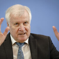 Horst Seehofer (CSU), Federal Minister of the Interior, for Construction and Home Affairs, presents the case figures of politically motivated crime for the year 2020 at the Federal Press Conference in Berlin, Germany, May 4, 2021. (Kay Nietfeld/dpa via AP)