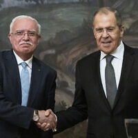Russian Foreign Minister Sergey Lavrov, right, and Palestinian Foreign Minister Riyad Al-Maliki shake hands as they leave a joint news conference following their talks in Moscow, Russia, May 5, 2021. (AP Photo/Alexander Zemlianichenko, Pool)