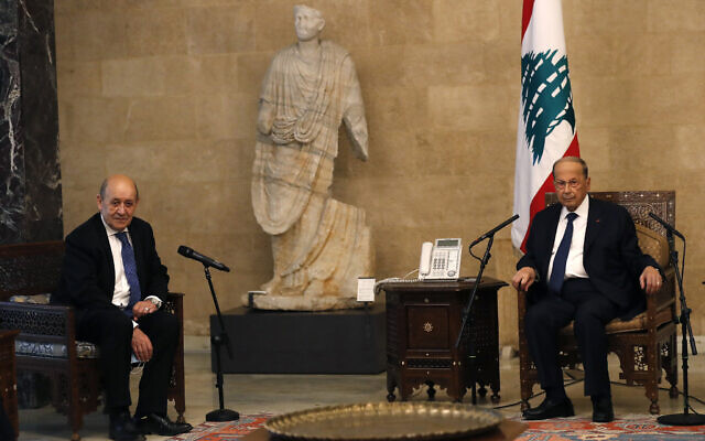 French Foreign Minister Jean-Yves Le Drian, left, meets with Lebanese President Michel Aoun at the Presidential Palace in Baabda, east of Beirut, Lebanon, May 6, 2021. (AP Photo/Hussein Malla)