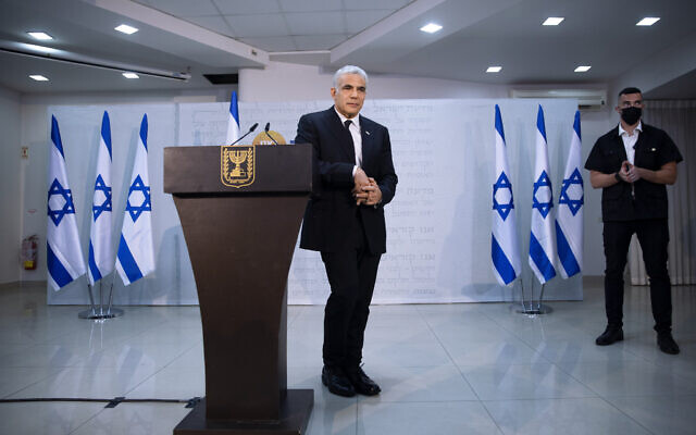 Yesh Atid leader Yair Lapid poses for a photo during a news conference in Tel Aviv, Thursday, May. 6, 2021.(AP Photo/Oded Balilty)