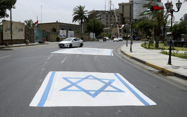 A representation of an Israeli flag is placed outside the 17th of Ramadan mosque during 'al-Quds' Day in central Baghdad, Iraq, May 7, 2021. (AP Photo/Hadi Mizban)