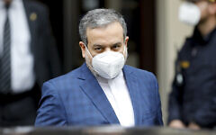 Political deputy at the Ministry of Foreign Affairs of Iran, Abbas Araghchi, leaves the 'Grand Hotel Wien' where closed-door nuclear talks take place in Vienna, Austria, May 7, 2021. (AP Photo/Lisa Leutner)