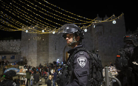 An Israeli police officer stands guard at the Damascus Gate to the Old City of Jerusalem after clashes at the Temple Mount, May 7, 2021. (AP Photo/Maya Alleruzzo)