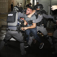 Israeli police officers clash with Palestinian protesters near Damascus Gate just outside Jerusalem's Old City on May 9, 2021. (AP/Ariel Schalit)